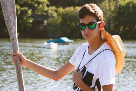 teen golf: young teenage boy with oar