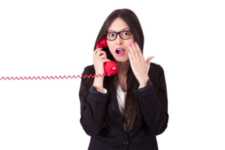 phone cord: angry businesswoman with phone cord Stock Photo