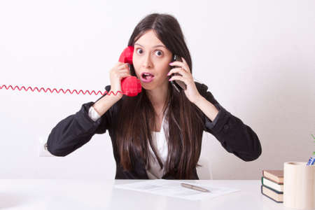 phone cord: angry businesswoman with phone cord and mobile