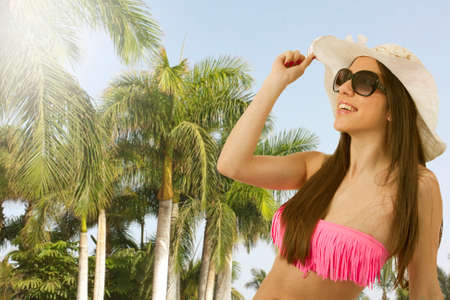 young girl bikini: bikini girl in the summer with palm trees Stock Photo