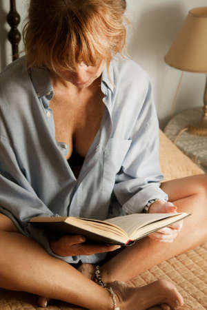 reading a book: real woman reading book, lifestyle