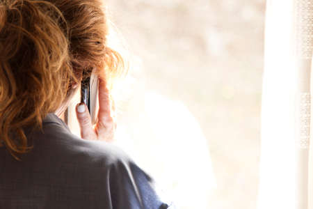 woman on phone: real woman with mobile phone