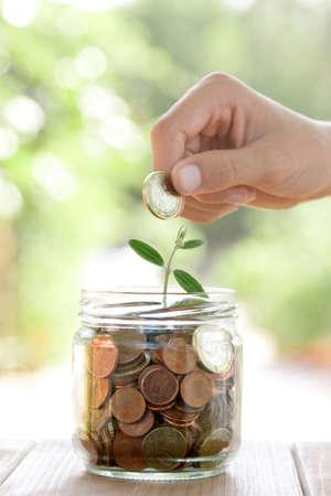 savings and loan crisis: pot with coins saving concept Stock Photo