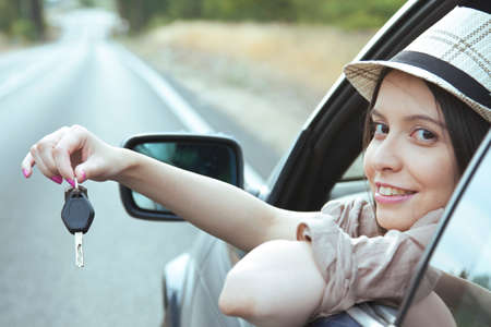 lifestyle shopping: girl in the car with the key