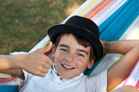 sublime: child in hammock smiling joy