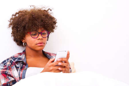 girl bed: young woman with mobile phone