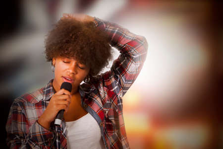 ballad: Girl singing with backlights