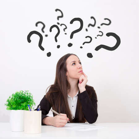 questions: woman in office with doubts and questions