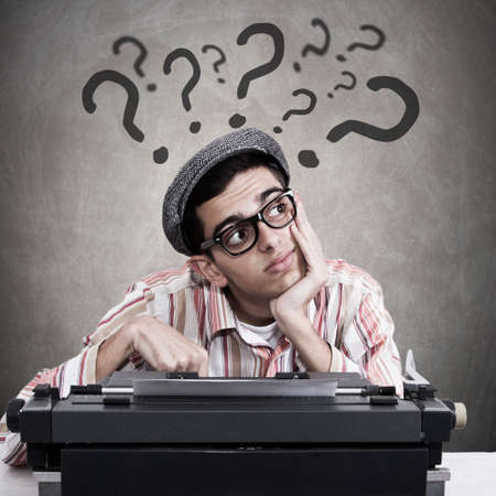 trading questions: man at office with doubts and questions