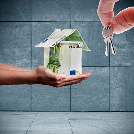 formalization: hands with house and key bills, buy house
