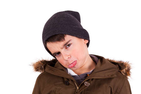whim of fashion: portrait of angry boy isolated on white Stock Photo