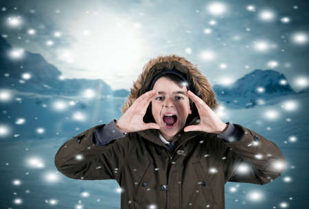 squealing: Portrait of boy crying in snow Stock Photo