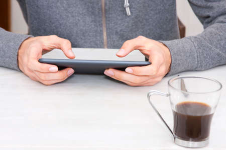 youngs: mobile tablet in the foreground on your desktop