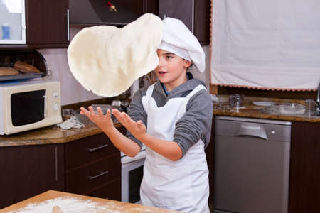pizza base: cook with pizza dough dela Stock Photo