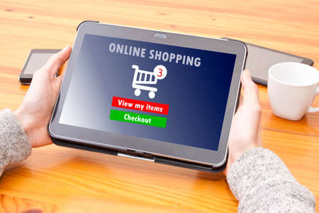 manos: hands with tablet and online shopping Stock Photo