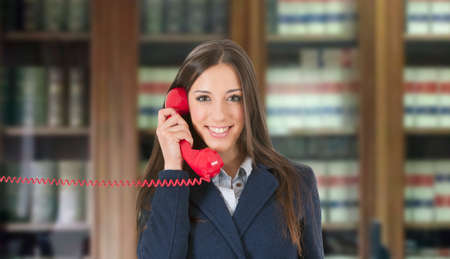 advisers: Business woman with vintage red phone