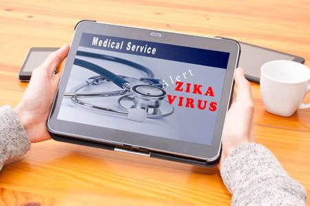 disease patients: zika virus alert on the Internet at digital tablet