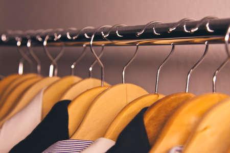 coat rack: coat rack with clothes on hangers hanging