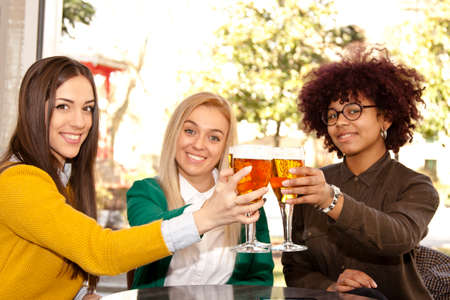 german ethnicity: young people celebrating with beer