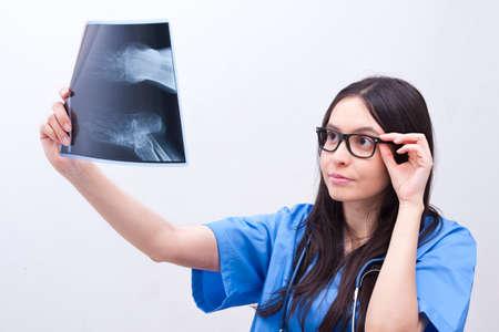 orthopedist: female doctor looking x-ray Stock Photo