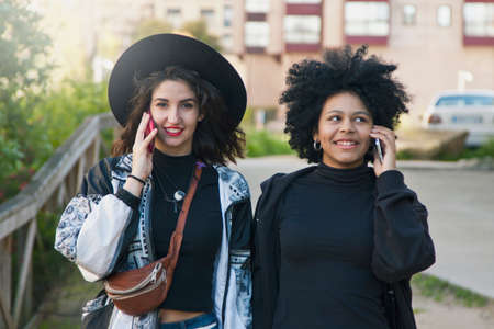 popular: girls talking on mobile phone Stock Photo