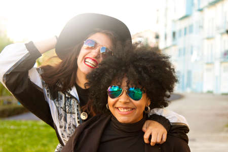 spontaneous expression: young friends having fun in the street Stock Photo