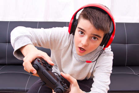 game console: child playing with game console