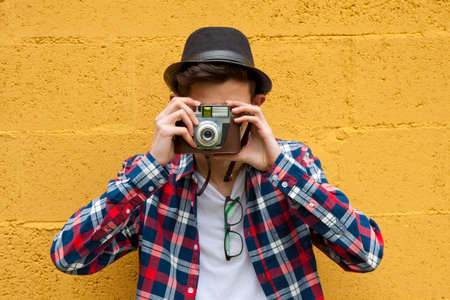 passerby: young guy with the camera travel
