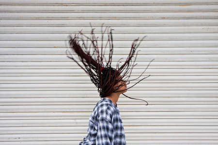 dreadlock: girl in the street with hair in the wind Stock Photo