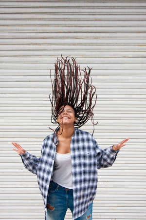 to flit: girl in the street with hair in the wind Stock Photo