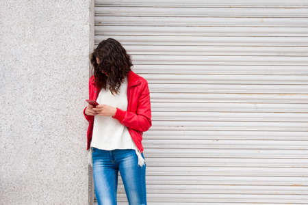 woman on phone: young woman with phone Stock Photo