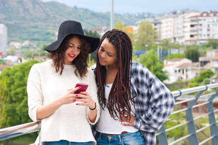electronica: girls chatting with mobile phone