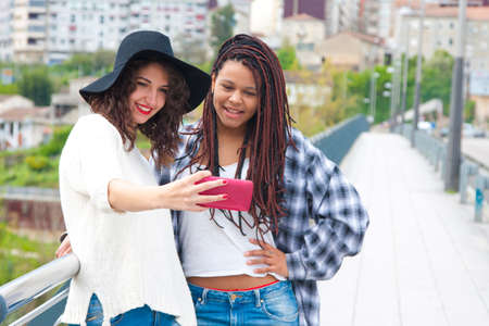 electronica: girls doing a selfie with mobile