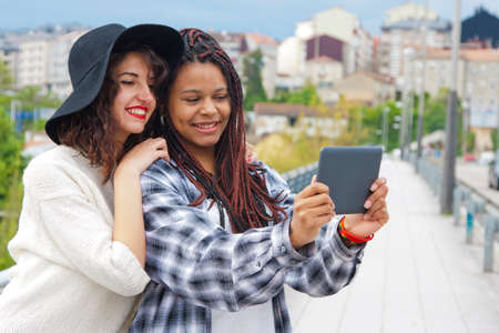 electronica: girls with tablet recording and taking pictures