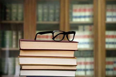 shortsightedness: glasses on the books piled Stock Photo