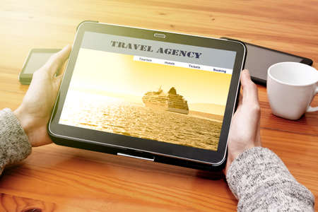 electronica: travel search engine on the tablet Stock Photo