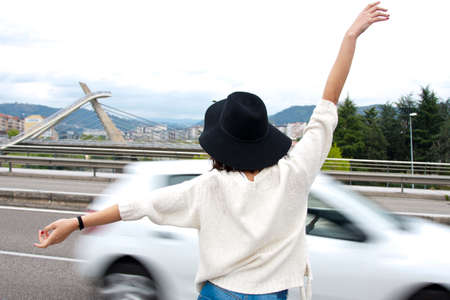 hitchhiking: girl hitchhiking Stock Photo
