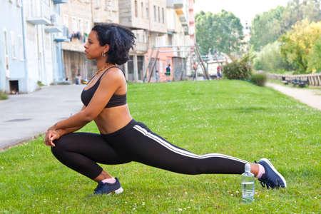 woman practicing yoga and gymnastics Stock Photo