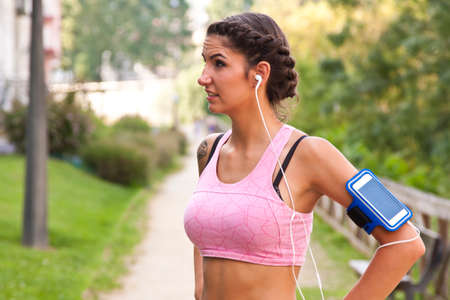 woman doing sport outdoors Stock Photo