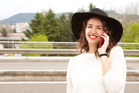 insurer: young woman talking on phone Stock Photo