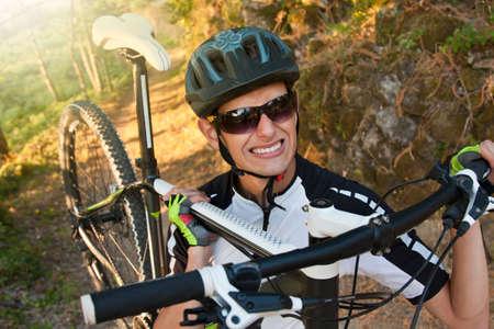 mountain biker: expression of effort mountain biker