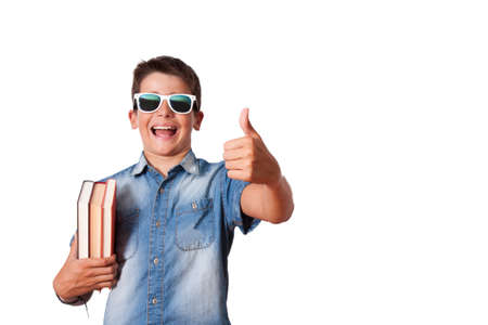 able to learn: isolated child with books and sign of approval