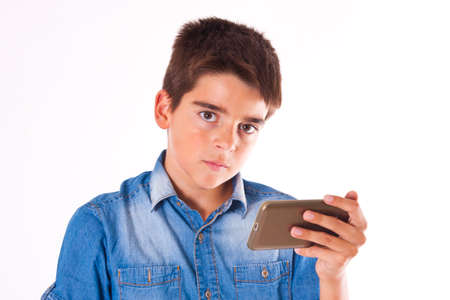 portability: child with mobile phone isolated