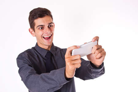 businessman playing with mobile phone