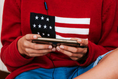 telephone in the foreground in the childs hands with American flag