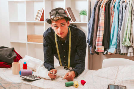 industry trends: young man working in the fashion workshop Stock Photo