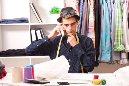 pret a porter: young man working in his textile business Stock Photo