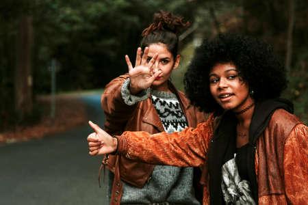 intrepid: two girls making funny hitchhiking