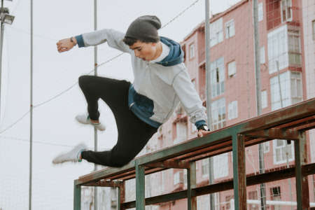 BACKFLIP: child outdoors practicing parkour