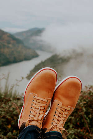 boots in the foreground on the panoramic view of the Valley, concept of adventure and travel